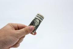 Изображение конца поднимающее вверх кавказской мужской руки держа примечание одного DollarUSA с простой предпосылкой Стоковое Фото