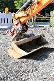 Изображение концепции ковша экскаватора - конструкции, развития Стоковое Изображение RF