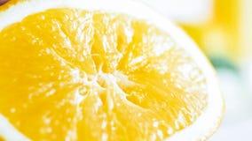 Изображение крупного плана влажной сочной оранжевой половины Стоковые Фотографии RF