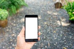 Изображение модель-макета руки женщины держа мобильными экран изолированный смартфонами белый для дизайна и других модель-макета  стоковые фото