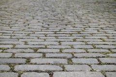 Изображение предпосылки серой дороги булыжника в горизонтальном положении Стоковые Изображения
