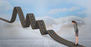 Изображение произведенное цифров коммерсантки стоя на волнистой дороге в небе Стоковые Изображения