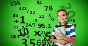 Изображение произведенное цифров мальчика держа книги при номера летая против зеленой предпосылки Стоковое фото RF