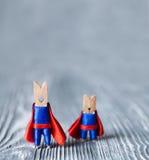 Изображение работы команды схематическое Супергерои зажимок для белья скопируйте космос стоковые изображения