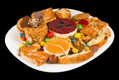 Изображение различных вкусных печений на крупном плане плиты Стоковая Фотография RF