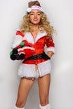 Изображение сексуальной девушки хелпера Santas большое для создавать открытки приветствию праздника Стоковые Фото
