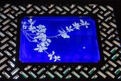 Изображение украшенное при окно сделанное из стекла внутри академии клана Chen Стоковые Фото