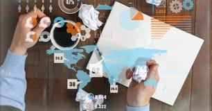 Изображение цифров составное бизнесмена с кофе и скомканными бумагами на столе Стоковое Изображение RF