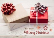 Изображение цифров составное с Рождеством Христовым против подарков рождества Стоковая Фотография RF