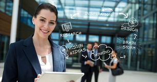 Изображение цифров составное уверенно бизнесмена держа ПК таблетки текстом и значками Стоковые Фотографии RF