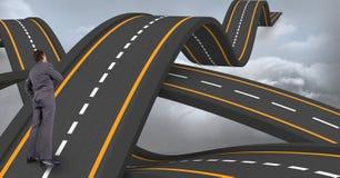 Изображение цифров составное confused исполнительной власти стоя на волнистой дороге водя к небу Стоковые Фото
