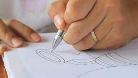 Изображение чертежа руки на белом холсте. акции видеоматериалы