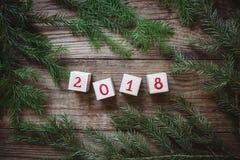Изображение sprigs и кубов рождественской елки с 2018 Стоковые Изображения RF