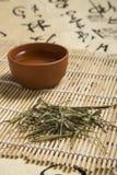 Изображения пурпура чая Reed и чашки чая Стоковое фото RF