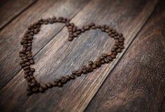 Изобразьте представлять душистое сердце сделанное из кофейных зерен Стоковая Фотография