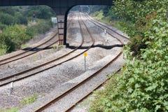 изогнутые следы железной дороги расстояния исчезая Стоковые Фотографии RF