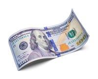 Изогнутый 100 долларовым банкнотам Стоковое Фото