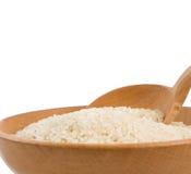 изолированная белизна ложки риса плиты Стоковая Фотография