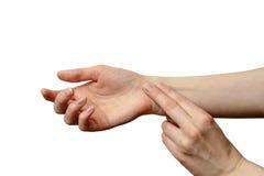 Изолированная женская рука для того чтобы измерить ИМП ульс Стоковое фото RF