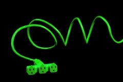 изолированная зеленым цветом белизна студии штепсельной вилки Стоковые Фото