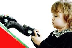 изолированная игра ребенка играющ видео Стоковое фото RF