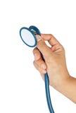 изолированная рукой белизна стетоскопа Стоковое Изображение