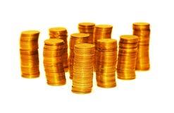 изолированное золото монеток штабелирует белизну Стоковая Фотография RF