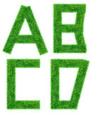Изолированное письмо зеленой травы Стоковое фото RF