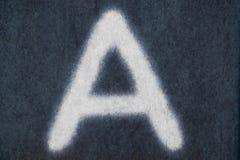 Изолированное письмо мела в предпосылке классн классного Стоковое Изображение RF