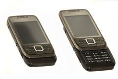 изолированное скольжение мобильного телефона Стоковое фото RF