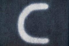 Изолированное c письмо мела в предпосылке классн классного Стоковые Изображения RF