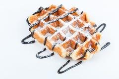 Изолированные бельгийские waffles при шоколад изолированный на белой предпосылке Стоковая Фотография
