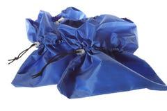 Изолированные голубые крышки ботинка на белой предпосылке Стоковая Фотография
