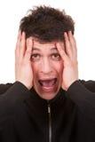 изолированные детеныши портрета человека screaming Стоковое фото RF
