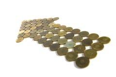 изолированные монетки стрелки стоковая фотография rf