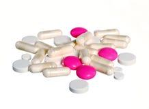 изолированные пилюльки pink белизна Стоковые Изображения RF