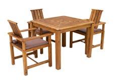 Изолированные таблица и стулы стоковые фото