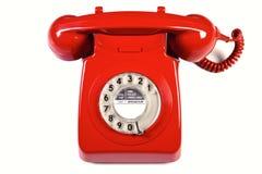 изолированный красный ретро телефон Стоковые Изображения