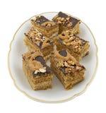 изолированный мед торта соединяет белизну плиты Стоковые Изображения RF
