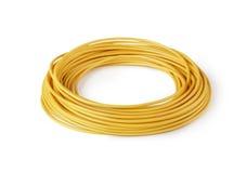 изолированный моточком желтый цвет провода Стоковое Изображение RF