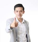 Изолированный портрет азиатского человека и предпосылки с знаком жеста Стоковые Фотографии RF