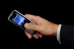 изолированный рукой передвижной телефон путя стоковая фотография