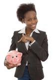 Изолированная афро американская коммерсантка с копилкой: деньги conc стоковое фото rf