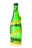 изолированная бутылкой измеряя белизна воды ленты Стоковое Изображение RF