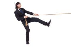 Изолированная веревочка молодого бизнесмена вытягивая Стоковое Фото