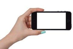 Изолированная женская рука держа умный телефон стоковое изображение rf
