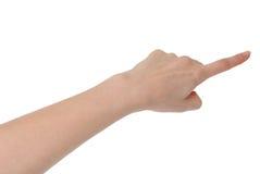 Изолированная женская рука касаясь или показывая что-то с индексом fi стоковое изображение