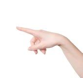 Изолированная женская рука касаясь или указывая стоковое изображение