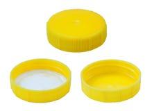 Изолированная желтая пластичная крышка Стоковая Фотография