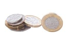 Изолированная куча новой монетки английского фунта Стоковое Изображение